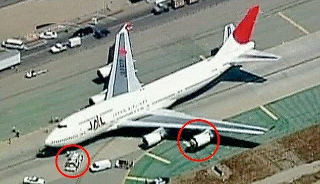 JAL 747 ingesting a baggage cart